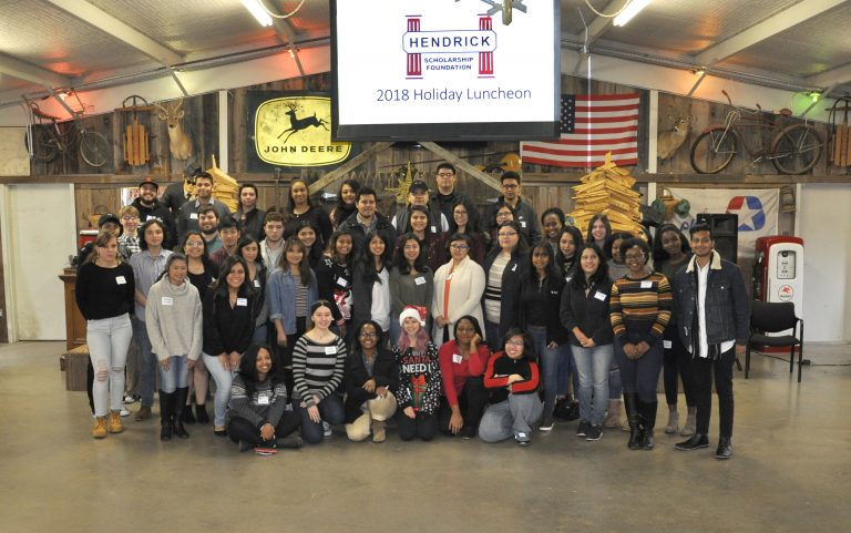 Large group posing for picture at holiday luncheon