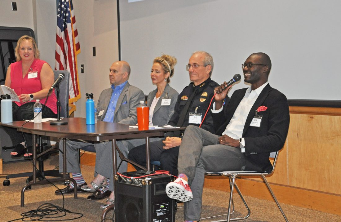 Four panelists discussing topics at a breakout session
