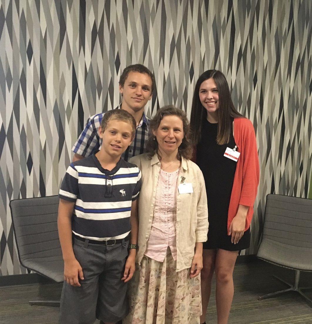 Emily Ayoubi posing with three members of the Platt family