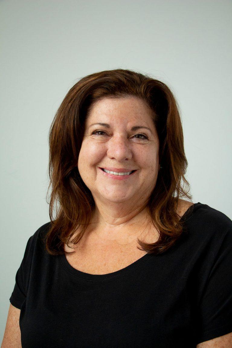 Marta Lilly, operations manager for Hendrick Scholarship Foundation. Head shot.